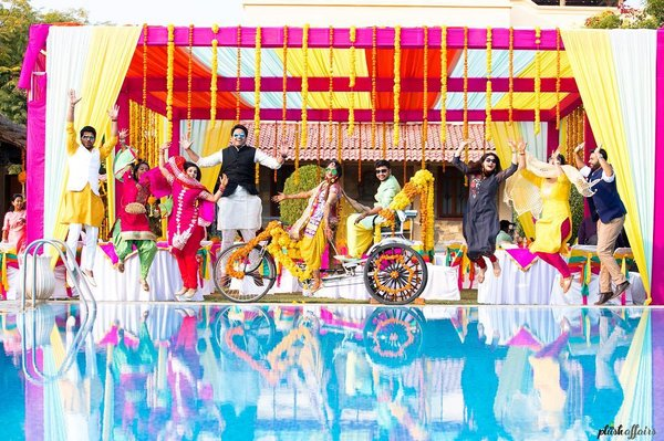 Wedding guests posing with cycle rickshaw